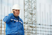 Foreman at construction site with mobile phone — Stock Photo