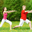 Young man and woman doing stretching exercises — ストック写真