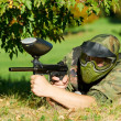 Paintball player aiming with marker — Stock Photo #10571560