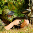 Paintball player aiming with marker — Stock Photo