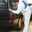 Stock Photo: Auto mechanic protecting car before polishing