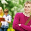 Stock Photo: Smiling student guy outdoors