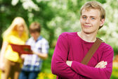 Smiling student guy outdoors — Stock Photo