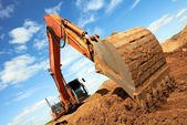 Track-type loader excavator at work — Photo