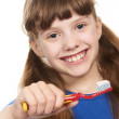 Smiling little girl with toothpaste on toothbrush — Stock Photo