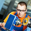 Industrial worker at sharpening machine tool — Stock Photo #10672631