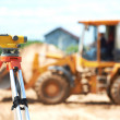 Surveyor equipment level at construction site — Stock Photo #10673160
