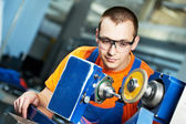 Industrial worker at sharpening machine tool — Stock Photo