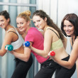 Healthy woman doing fitness exercise with dumbbell — Stock Photo