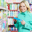 Woman at household chemistry shopping — Stock Photo