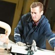 Стоковое фото: Worker at workshop with circ saw