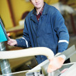 Stock Photo: Worker at workshop with circ saw