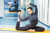 Happy smiling woman at gymnastic fitness exercise — Stock Photo