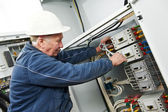 Electrician tighten the screws with spanner — Stock Photo
