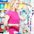 Woman at household chemistry shopping - Stock Photo