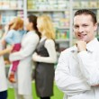 Royalty-Free Stock Photo: Confident pharmacy chemist man in drugstore