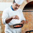 Arab baker chef making Pizza — Stock Photo #8038387