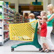 Stock Photo: Womand children making shopping