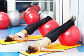 Women at exercise with fitness ball — Stock Photo