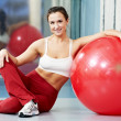 Happy healthy woman with fitness ball — Stock Photo