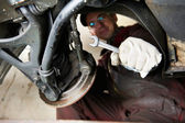 Machanic repairman at car break change — Stockfoto