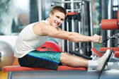 Positive man at back exercises — Stock Photo