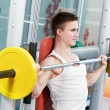 Bodybuilder man doing biceps muscle exercises - Stock Photo