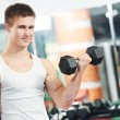 Bodybuilder man doing biceps muscle exercises — Stock Photo #8127795