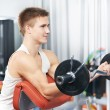 Bodybuilder man workout biceps muscle exercises - Stock Photo