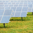 Ecology energy farm with solar panel battery field - Stock Photo