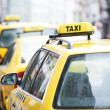 Yellow taxi cab cars — Stock Photo #8539367
