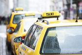 Yellow taxi cab cars — Stock Photo