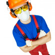 Постер, плакат: Builder in hardhat earmuffs goggles and gas mask