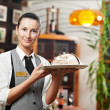 Waitress girl with cake on plate at restaurant — Foto Stock