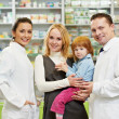 Pharmacy chemist, mother and child in drugstore — Stock Photo #8732496