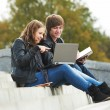 Two smiling young students outdoors — Stock Photo #8732713