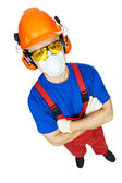 Builder in hardhat, earmuffs, goggles and gas mask — Stock Photo