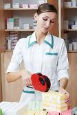 Pharmacy chemist woman labeling drugs — Stock Photo
