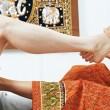 图库照片: Traditional thai massage health care foot kneading