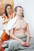 Traditional thai massage health care back kneading — Stock Photo