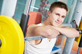 Bodybuilder man doing muscle exercises with weight — Stock Photo