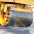 Stock Photo: Compactor roller at asphalting work