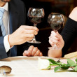 Stock Photo: Mand girl hands with wine at cafe on date