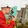 Surveyor works with theodolite — Stock Photo #8875957