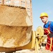 Builder worker at construction site - Stock Photo