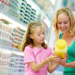 Woman and girl making shopping - Stock Photo