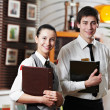 Waitress girl and waiter man in restaurant — Stockfoto