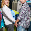 Young couple at clothes shopping — Stock Photo #8879512