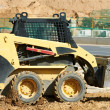 Skid steer loader at earth moving works — Stock Photo #8879598