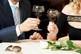 Man and girl hands with wine at cafe on a date — Stock Photo